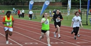 Crossing the finish line first in the 100m